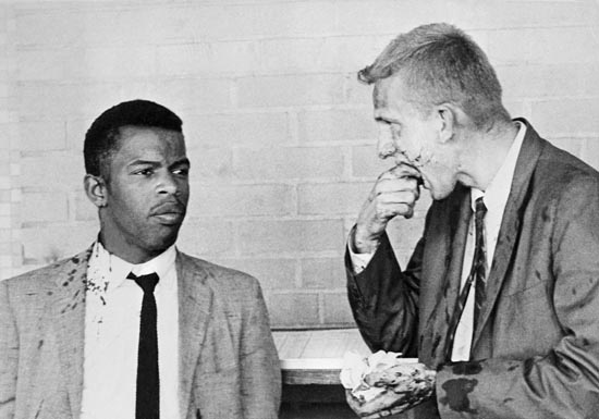 20 May 1961, Montgomery, Alabama, USA --- Two blood-splattered Freedom Riders, John Lewis (left) and James Zwerg (right) stand together after being attacked and beaten by pro-segregationists in Montgomery, Alabama. --- Image by © Bettmann/CORBIS