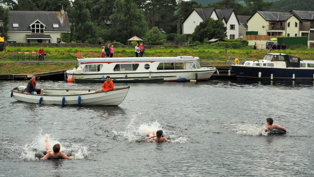 The sitting-in-a-tube-splash-backwards-across-the-river race.